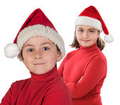 Two children with Christmas cap — Stock Photo