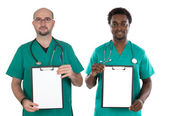 Medical team with clipboard and blank paper — Stock Photo
