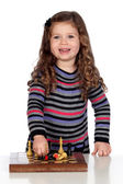 Adorable baby playing chess — Stock Photo