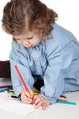 Beautiful girl painting with preschool uniform — Stock Photo