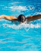 Swimmer in swimming pool — Stock Photo