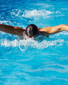Swimmer in a swimming pool — Stock Photo