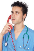 Doctor speaking on the telephone — Stock Photo