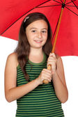 Pretty teen girl with a red umbrella — Stock Photo