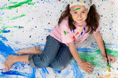 Girl playing with painting — Stock Photo