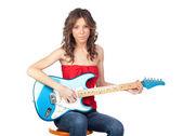 Beautiful girl with a electric guitar — 图库照片