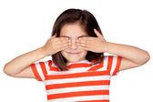 Brunette little girl covering the eyes — Stock Photo