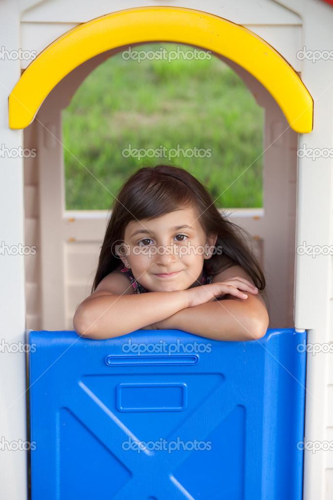 Beautiful plastic playhouse with smiling little girl  Stock Photo #9625088