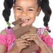 Adorable girl eating chocolate — Stock Photo