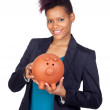 African girl with a big moneybox — Stock Photo