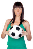 Beautiful girl with a soccer ball — Stock Photo