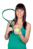 Beautiful girl with a tennis racket — Stock Photo