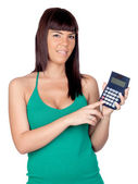 Beautiful girl with a calculator isolated — Stock Photo