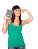 Nadenkend meisje met een boek — Stockfoto
