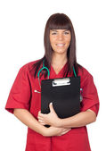 Happy doctor woman with clipboard — Stock Photo