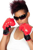 Exotic african girl with sunglasses and boxing gloves — Stock Photo