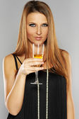 Beautiful woman in 30s drinking wine — Stock Photo