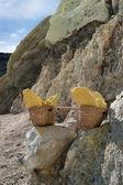 Baskets of sulphur, Kawah Ijen volcano, Java, Indonesia — Stock Photo
