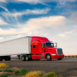 Red truck moving on a highway — Stock Photo