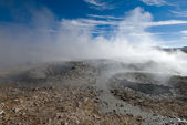 Mud geyser over blue sky, altiplano, bolivia — Stock Photo