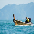 Fisherman in a boat - Stock Photo