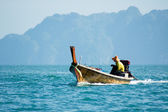 Fisherman in a boat — Stock Photo