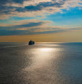Cruise liner in the sea at sunset — Stock Photo