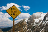 Rock slide area sign in the mountains — Stock Photo