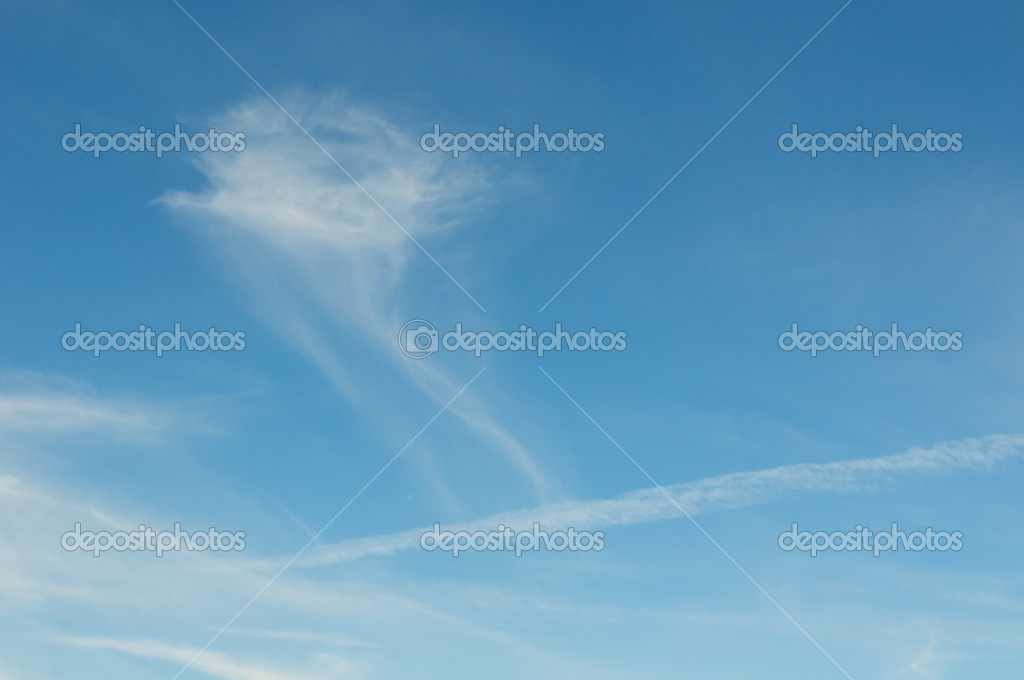 White clouds over deep blue sky background — Stock Photo #9388341