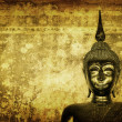 Buddha over grunge wall - Stock Photo
