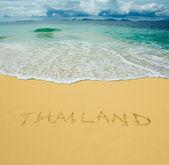 Thailand written in a sandy tropical beach — Stock Photo