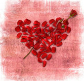 Grunge background with heart made od rose petals — Foto Stock