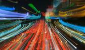 Traffic lights in motion blur — Stock Photo