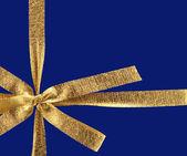 Golden gift ribbon — Stock Photo