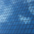 Stock Photo: Sky reflecting in windows of office building