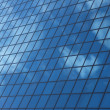 Sky reflecting in windows of office building — Stock Photo