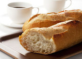 French bread and coffee — Stock Photo