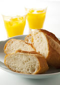 French bread and orange juice — Stock Photo
