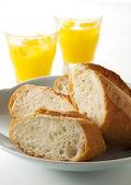 French bread and orange juice — Stock Photo