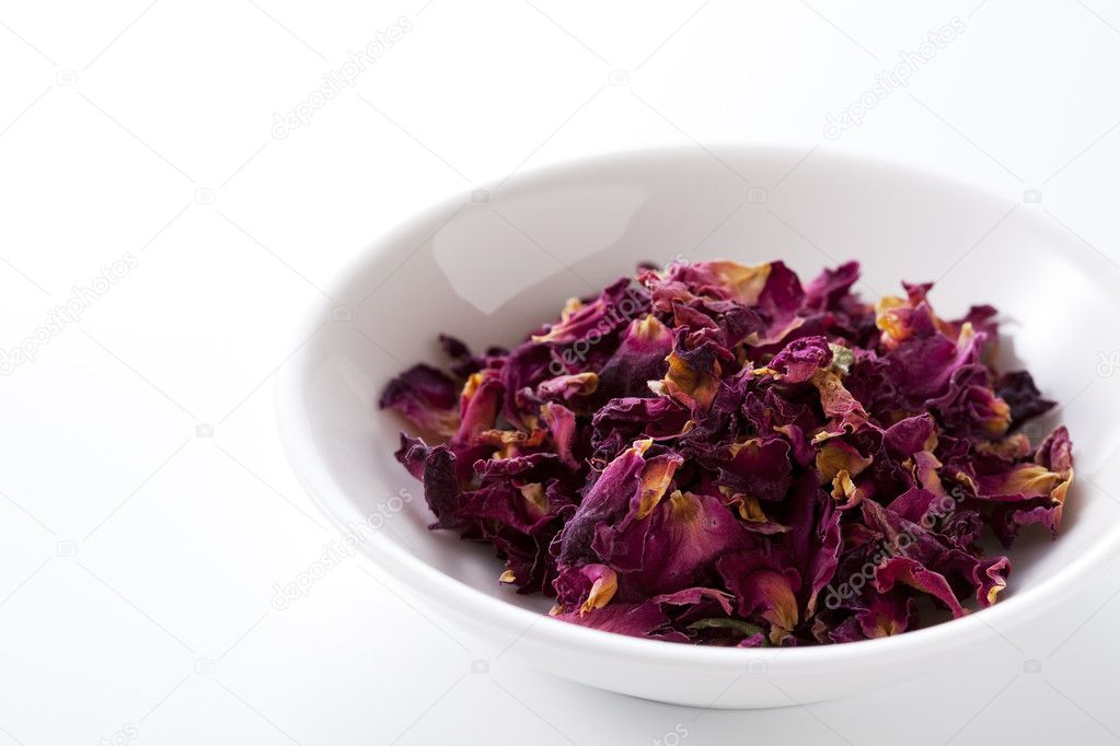 Dried rose went into a white porcelain bowl — Stock Photo #9328183