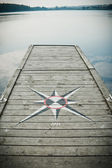 Bridge with a compass — Stock Photo