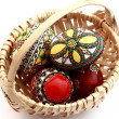 Easter eggs in a trellis basket — Stock Photo