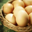Easter eggs in brown natural basket — Stock Photo