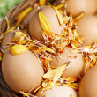 Stock Photo: Flower decorated Easter eggs in brown natural basket