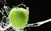 Fresh green apple underwater — Stock Photo