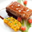 Crispy pork fillet with mango chutney. — Stock Photo
