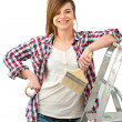 Stock Photo: Friendly female painter with paint brush.