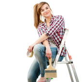 Cute female painter sitting on ladder. — Stock Photo
