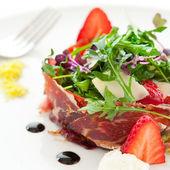 Green salad with spanish ham. — Stock Photo