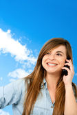 Smiling girl on cellphone outdoors. — Stock Photo